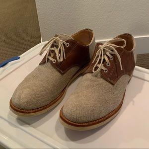 Brown and cream saddle style shoes.